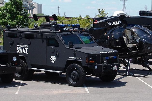 "SWAT Team Fires Semi-Automatic Weapons At Unarmed Teenage Girl Members of a SWAT team opened fire on an unarmed teenage girl this week when police officers outside of Washington, DC attempted to serve an early morning search warrant. Myasia Hughley, 18, is recovering from flesh wounds following Thursday morning's events in District Heights, Maryland. She was asleep in her bedroom at her family house when 15 FBI SWAT agents stormed the house with guns drawn. ""I'm shouting 'Nobody is armed, nobody has a gun!' and then all of a sudden I heard 'She's got a gun!' and they just opened fire,"" Emory Hughley, Myasia's father, tells local station WJLA News. Myasia didn't have a gun, though, nor did any other member of the Hughley household. The authorities allegedly saw something, and in their minds had enough reason to unleash a barrage of bullets at the girl. Mr. Hughley tells Washington's NBC News4 that he saw one agent even fire off around seven shots himself using a semi-automatic weapon. ""They almost hit my daughter, man,"" he adds to WJLA. ""If I hadn't told her to go back in her room they probably would have shot her."" ""I've got eight holes in my wall. One bullet went past my head, almost hit me, ricocheted off my brick wall and some of the shrap metal hit my little daughter in the back of her neck, all for nothing."" The Hughleys are now asking for answers from the FBI, but so far the authorities have stayed silent as to why they were raiding the home. Mr. Hughley says a day later that he has yet to be told why his house was visited in the early morning hours by more than a dozen heavily armed FBI agents other than they were executing a search warrant. The FBI's Washington Field Office has deferred from answering pleas from the press to explain what the judge-approved order was for."