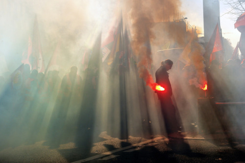 Philippe Huguen—AFP/Getty Images  Nov. 14, 2012. A man holds a flare as thousands of people from France and Belgium demonstrate during an anti-austerity protest in Lille, France. Read more: http://lightbox.time.com/2012/11/16/pictures-of-the-week-november-9-november-16/#ixzz2CWkdJqh6