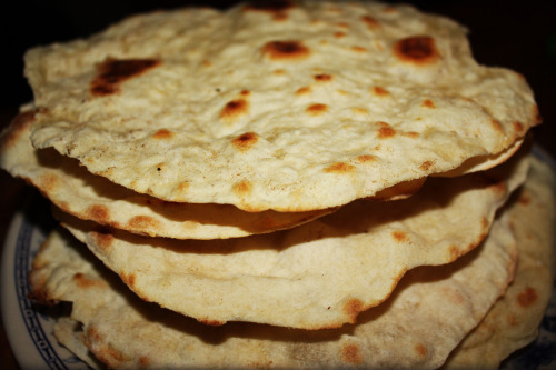 HOMEMADE FLOUR TORTILLAS We have been talking about making these for forever. We've also been avoiding making these for forever. But yesterday was the day to stop avoiding our fears! The result was well worth it. But I won't lie, rolling out each piece of dough was, whew, exhausting. I traded doing the dishes for two days if A would roll out all the dough. I still think that trade was worth it. Ingredients: 3 cups unbleached Flour 1 teaspoon Salt ½ teaspoons baking powder ⅓ cups canola oil 1 cup hot water Directions: 1. Mix the flour, salt, and baking powder with a whisk.2. Add the canola oil and mix with your fingers until all the oil is incorporated and the mixture looks like fine crumbs. Add 1 cup of hot water and mix until a ball is formed.3. Cover with plastic wrap and let the dough rest for about 30 minutes. (You can also refrigerated it overnight).4. Divide the dough into 12 balls and roll out one at a time on a floured surface. Brush off excess flour.5. Cook on a hot, ungreased griddle over medium-high heat. Turn the tortilla when brown blisters form on the first side. Stack the tortillas and serve warm.
