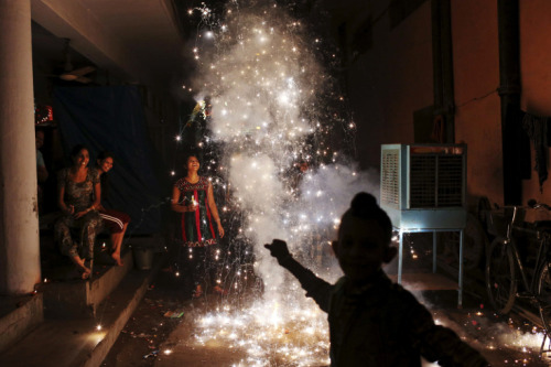 Kevin Frayer—AP  Nov. 13, 2012. An Indian family lights firecrackers during the festival of Diwali in New Delhi. Read more: http://lightbox.time.com/2012/11/16/pictures-of-the-week-november-9-november-16/#ixzz2CWn7p4Yc