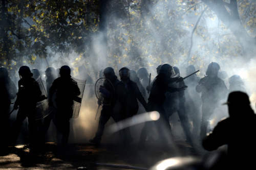Filippo Monteforte—AFP/Getty Images  Nov. 14, 2012. Demonstrators fight with riot policemen during a protest on a day of mobilization against austerity measures by workers in Rome. Read more: http://lightbox.time.com/2012/11/16/pictures-of-the-week-november-9-november-16/#ixzz2CWo3QBZX