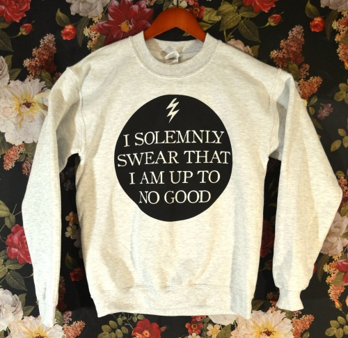death-by-lulz:  Wicked Clothes is proud to present our latest item: the 'I Solemnly Swear That I Am Up To No Good' Sweater! This lovely ash grey sweater will keep you warm all winter long. On top of being on sale for a limited time, use coupon code '1000NOTES' for an EXTRA 10% off your ENTIRE order! Hurry and order now!