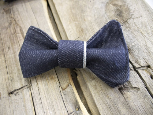 This Japanese denim bow tie is crafted one at a time by hand in our workshop in downtown Los Angeles. This bow tie is made from raw heavy weight Kaihara Selvedge. All bow ties are stitched twice to ensure they last a long time in your wardrobe. Each bowtie comes with a den.m bar clip. Be the first in your group to rock this stylish denim bow tie!  Material: Kaihara Selvedge Weight: 13.5 oz. Dimensions: 3 x 5 Type: Clip-On About den.m bar's Tie collection. All of our ties are crafted with the fine dapper in mind. We know you prize individuality, class & sophistication. We use only American and Japanese denim and stitch each tie on 1970's era Juki & Union Special sewing machines.
