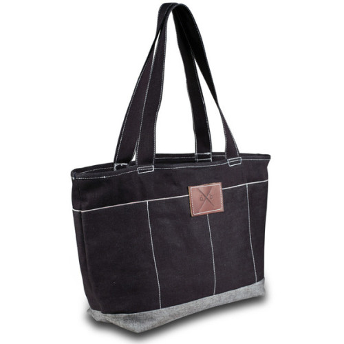 "This handcrafted denim bag is made with Japan based Nisshinbo denim. Heavy weight selvedge denim lets us build a tough and functional bag large enough to stock breakfast, lunch and a beach towel or three. Six exterior pockets provide extra storage space. Our custom denim bags are cut & sewn one at a time and no two bags are exactly alike.  Designed by Aileen Coyle, our fabulous seamstress/future kickass designer.   Mill: Nisshinbo Denim Weight: 13.5-14.0 oz. Dimensions: 22"" x 15"" x 9"" (approximate) Type: Triple stitched in stress areas to last any beating you can give the bag."