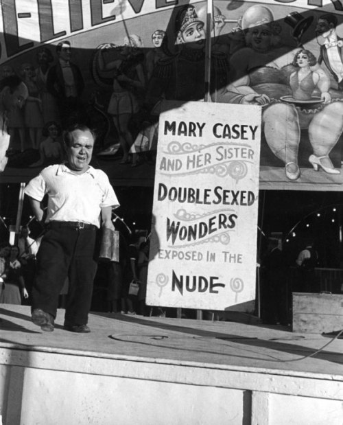 "abeautifulfighter:  West Virginia Country Fair 1938. ""Dwarf man barked for hermaphrodites."""