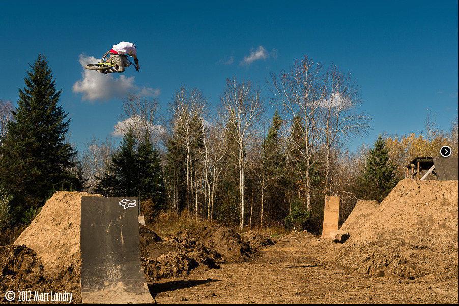 Brett Rheeder laying out a table in his compound for a feature over on Riding Feels Good.  [o] Marc Landry  Check it out, tons of good photos and words over there. Bretts got it goin on.