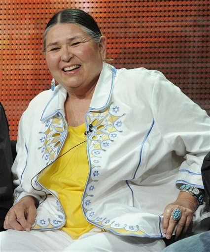 "Sacheen Littlefeather is a Native American woman who is a civil rights activist. She is known for dressing in Apache dress and presented a speech on behalf of actor Marlon Brando, for his performance in The Godfather, when he boycotted the 45th Academy Awards ceremony on March 27, 1973, in protest of the treatment of Native Americans by the film industry. Littlefeather was born Marie Louise Cruz[1] November 14, 1946, Salinas, California,[2]U.S.). Littlefeather's heritage includes Apache, Yaqui, Pueblo, and European ancestry. On her official website, she states her father was from the White Mountain Apache and Yaqui tribes from Arizona and that ""Cruz"" is her father's recognized tribe name.[3] A member of Indians of All Tribes, Littlefeather had participated in the occupation of Alcatraz Island by American Indians' rights activists in 1969.[4] Marlon Brando became involved with the American Indian Movement (AIM) in the early 1970s. In 1973, he decided to make a statement about the Wounded Knee incident and contacted AIM about providing a person to accept the Oscar for him. Dennis Banks and Russell Means picked Sacheen Littlefeather.[citation needed] She represented Brando and his boycott of the Best Actor Oscar for The Godfather (1972), as a way to protest the ongoing siege at Wounded Knee and Hollywood's and television's misrepresentation of American Indians. Brando had written a 15-page speech for Littlefeather to give at the ceremony, but when the producer met her backstage he threatened to physically remove her or have her arrested if she spoke on stage for more than 60 seconds.[5] Her on-stage comments were therefore improvised. She then went backstage and read the entire speech to the press. In his autobiography My Word is My Bond, Roger Moore (who presented the award) claims he took the Oscar home with him and kept it in his possession until it was collected by an armed guard sent by the Academy.  This woman is a force to be reckoned with."
