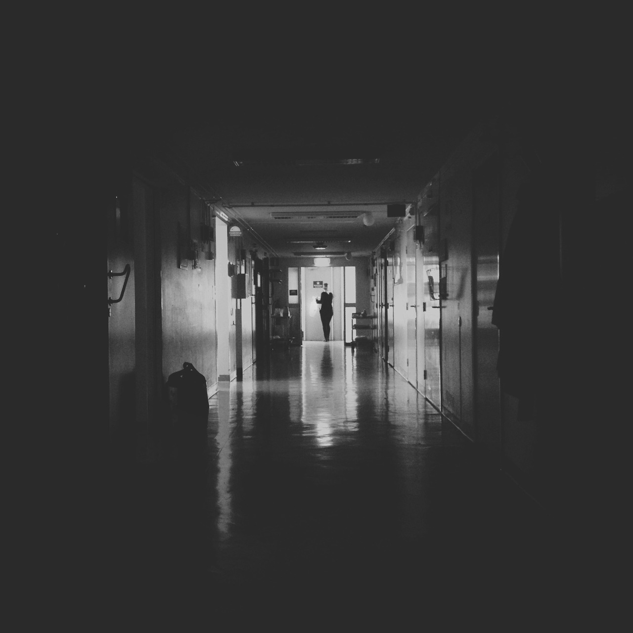 A quick b&w snapshot from the hospital set of our dear Caroline carrying a bag of…party hats? Guns? Lamingtons? I don't know, either way, she did it like a baws.