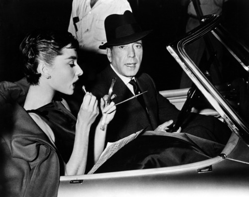 "Audrey Hepburn and Humphrey Bogart attending the premiere of Sabrina (Dir. Billy Wilder) in 1954.  ""With Audrey it's kind of unpredictable. She's like a good tennis player—she varies her shots."""
