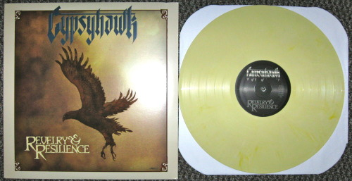 "Gypsyhawk - ""Revelry & Resilience"" (Metal Blade Records 2012) I had to pleasure of watching Gypsyhawk perform on Wednesday in NYC opening for The Sword.  Let me say, they were fucking awesome.  I had no idea who they were, as I hadn't heard of them before the show, but I was floored.  They all had long hair, two of them were wearing bell bottoms and they said stuff like ""This song is about sitting in traffic, its called LOCOMOTION!"" or ""This song is about something important to me; GETTING HIGH!"" So if those quotes and the name of this band aren't any indication, they play heavy metal in the traditional way, from the late 70's.  Like a healthy dose of Judas Priest, Thin Lizzy, and Mercyful Fate all mashed up into one delicious stew of harmonized guitar leads and songs about frost wyrms.  If you notice the bands I just compared Gypsyhawk to, they must seem strangely similar to the bands that influenced an obscure band by the name of Metallica.   The best way to describe the sound of this band, and I've been trying to think of another comparison because it's so easy but I can't, is the first disc of Metallica's ""Garage Inc.""  Like this album sounds EXACTLY like that album (only with original songs)(well one cover: ""Rock And Roll Hoochie Koo"").  That's not a bad thing, some idiots who hate any Metallica after ""And Justice For All"" poo-poo that part of the record because it's new stuff, but to me it's seriously one of the best cover albums ever! But seriously this album is a total nostalgia trip for the band I'm sure, but fuck it's such a refreshing sound.  This band just plain fucking ROCKS! I'd do everything in my power to procure a copy of this record.  Unless you are a trendy ass poser.  Which you will be if you don't buy this record.  -Log."