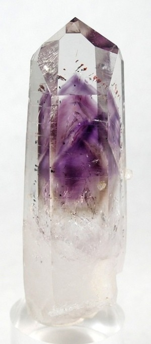 "fuckyeahmineralogy:  lapidarist:  quartz with amethyst phantom  ""Phantom quartz"" forms when quartz grows on top of a preexisting crystal.  Amethyst, a purple variety of quartz, is at the center of this one, while you can also see different colors, including clear, barely visible ""phantoms""."