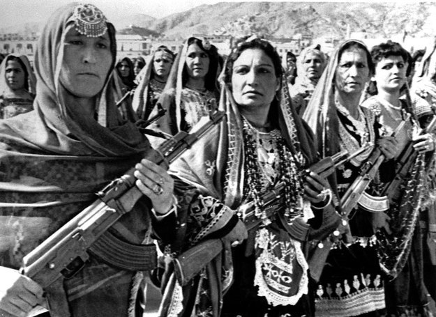 simply-war:  Afghan women carry Soviet manufactured AK-47's during a parade of village defense forces in 1988.