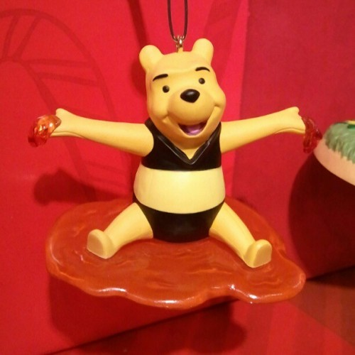 kelbebop:  I think Pooh is supposed to be dressed as a bee, but it looks like he's sporting a stylish black two-piece. Kudos, Hallmark.