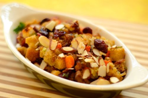 Thanksgiving Sides: Cider Sausage Stuffing with Fennel, Leeks, & Dried Cranberries I made two kinds of stuffing for our Thanksgiving party today and froze them until Thanksgiving. If you're cooking for a lot of people, it's easier to do as much as possible ahead of time and put it in the freezer until the day of the party. That way you can just pop it in the oven for the last hour that the turkey cooks. Bread freezes well, so this is a good thing to make ahead. Make sure to thaw this in the fridge before baking. This version of stuffing includes seared and caramelized Italian sausage, which was cooked and drained and added back at the end. I also added fresh chopped fennel from our front yard garden, apple cider (along with the stock or veggie broth), chopped leeks, dried cranberries and toasted almonds. You prepare this the same way as the stuffing I posted earlier, adding chopped leeks and fennel to the vegetable saute at the beginning, and 1 cup of apple cider in the broth stage.  This also has dried cranberries added at the mixing stage with toasted sliced almonds. It's delicious!