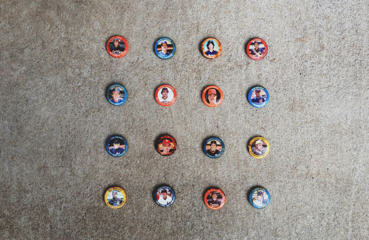 SUBMISSION: A bunch of old baseball pins found in a burnt down house. Photography by Matt Wrightson