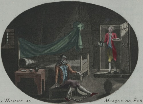 """L'Homme au Masque de Fer"" (""The Man in the Iron Mask""). Anonymous print (etching and mezzotint, hand-colored) from 1789. @credits   The Man in the Iron Mask (French: L'Homme au Masque de Fer) is a name given to a prisoner arrested as Eustache Dauger in 1669 or 1670, and held in a number of jails, including the Bastille and the Fortress of Pignerol (today Pinerolo). He was held in the custody of the same jailer, Bénigne Dauvergne de Saint-Mars, for a period of 34 years. He died on 19 November 1703 under the name of Marchioly, during the reign of Louis XIV of France (1643–1715). The possible identity of this man has been thoroughly discussed and has been the subject of many books, because no one ever saw his face, which was hidden by a mask of black velvet cloth. In the second edition of his Questions sur l'Encyclopédie (French for ""Questions on the Encyclopedia""), published in 1771, the writer and philosopher Voltaire claimed that the prisoner wore an iron mask and was the older, illegitimate brother of Louis XIV. In the late 1840s, the writer Alexandre Dumas elaborated on the theme in the final installment of his Three Musketeers saga: here the prisoner is forced to wear an iron mask and is Louis XIV's twin brother. What facts are known about this prisoner are based mainly on correspondence between his jailer and his superiors in Paris."