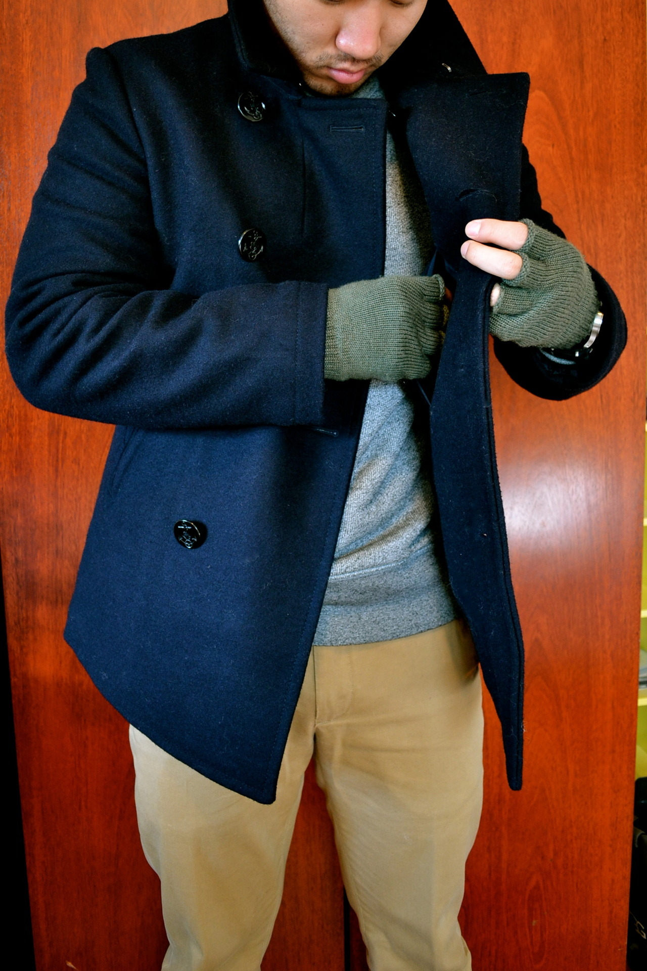 Pockets ain't empty.  Jacket by J. Crew Sweater by Levi's Pants by Rugby Gloves by Supreme