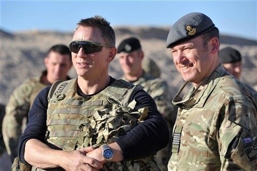 "James Bond visits UK troops in Afghanistan (Photo: Reuters) James Bond actor Daniel Craig surprised British troops in Afghanistan on Sunday by turning up at Camp Bastion in Helmand Province to introduce the latest 007 movie ""Skyfall"" as 800 soldiers sat down to watch it.   Read the complete story."