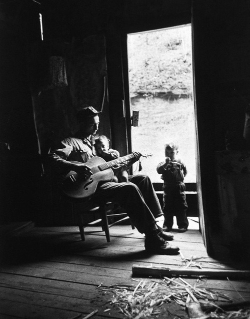 A father singing to his children. Photograph by Eliot Elisofon. Leslie County, Kentucky,  December 1949.