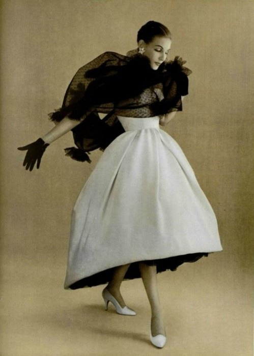 theniftyfifties:  Model wearing a gown by Christian Dior for L'Officiel de la Mode, Autumn 1957.