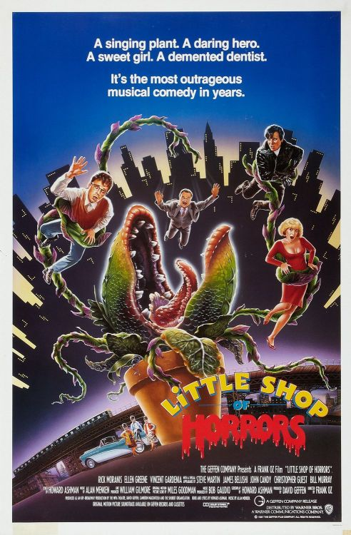 Little Shop Of Horrors (1986) Pros The musical as a film genre went through some dark days between the early seventies through to the release of 'Chicago' and 'Moulin Rouge', and one of the few (and brightest) highlights in the gloom was 'Little Shop of Horrors'. Taking the Off-Broadway musical as its model, which in its turn had been based on one of Roger Corman's classic low budget genre flicks, this 1986 Frank Oz directed film hits so many positive notes as a musical, as a comedy, as a special effects film and as a romance. As much as this is a movie with some solid (or even better) from its Hollywood stars such as Rick Moranis, Vincent Gardenia, Steve Martin and a hilarious cameo from Bill Murray, the two greatest performances of 'Little Shop…' are from Ellen Greene as Audrey, and Levi Stubbs' voiced puppet plant, Audrey II. Greene is a revelation as the meek, battered and beautiful flower arranger who looks to escape skid row with Rick Moranis' Seymour Krelborn. Thank goodness neither mooted 'Audreys' Cyndi Lauper nor Barbara Streisand got this role. Greene has a wonderful singing voice and in this film she combines that with some exquisite comedic timing. 'Audrey II' is a triumph of puppetry, not seen outside the likes of 'Labyrinth' and with Levi Stubbs providing the voice the monster is surprisingly likeable. Between Greene and Stubbs these two voice talents achieve some great musical moments (also attributable to Howard Ashman and Alan Mencken, the writers of 'Little Shop..' score and lyrics). The innate comedy of the film's premise is well realised thanks to the participation of many Second City/Saturday Night Live alumni (i.e. Moranis, Murray, Martin, John Candy, Jim Belushi). Martin's sadistic dentist is one of his best efforts from the 1980s, whilst Rick Moranis does very well as the nebbish lead and romantic hero. Cons Depending upon how closely you wish a film to follow the original story/show, 'Little Shop of Horrors' is perhaps an example of the unfortunate reliance of studios on test audiences to make creative decisions. The recently released Blu-Ray and earlier DVD editions show the original ending, which was cut due to its negative response, and it could be said that the movie's been changed too much from its original form. I tend to disagree with this point, however it must be cited for anyone familiar with the Corman film or Off-Broadway musical. Final Rating  3 out of 5 Bill Collins