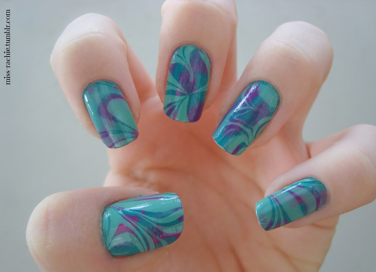 miss-rachie:  Watermarble :) Colors used:Maybelline mini Colorama: Urban turquoiseOPI - Pink flamencoOPI - Mermaid's Tears