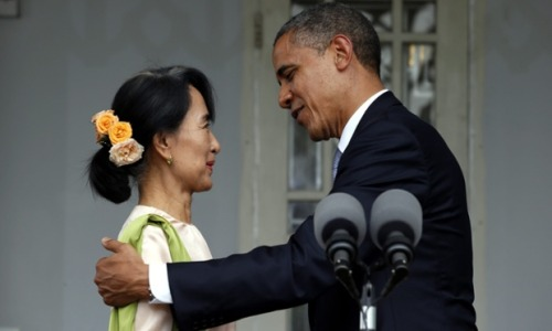 MOMENT of the day: Barack Obama and Burma opposition leader Aung San Suu Kyi after they delivered statements expressing hope for Burma's further progress after their meeting at her house in Rangoon.  Photograph: Barbara Walton/EPA
