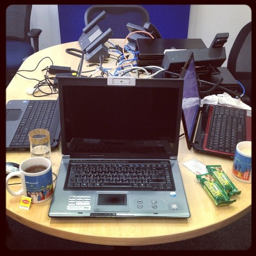 Mine and Noha's workstation at @Microsoft. Yes, between us, there's three laptops. :) (at Al Moayyed Tower)
