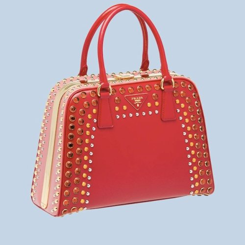Here's one for your holiday wish lists: Prada's studded Pyramid bag.