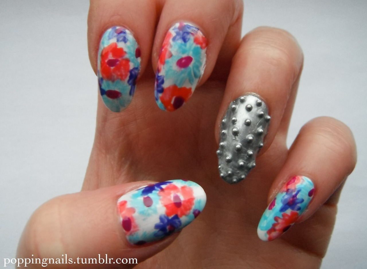 poppingnails:  I wanted to mix hard and soft in these nails so I chose this metal design and mixed it with a soft floral and got a terminator finger! Check out my blog to see how I created these nails