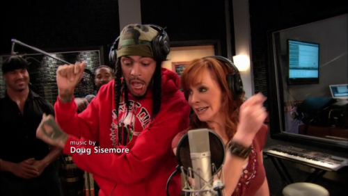 "Travie McCoy and Reba McEntire sang a duet on her new sitcom, Malibu Country, prompting everyone on Facebook who likes ""everything but rap and country"" to rise up and yell ""I TOLD YOU SO."""