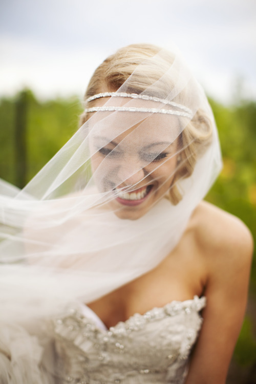my good friend jessica laughing on her wedding day.