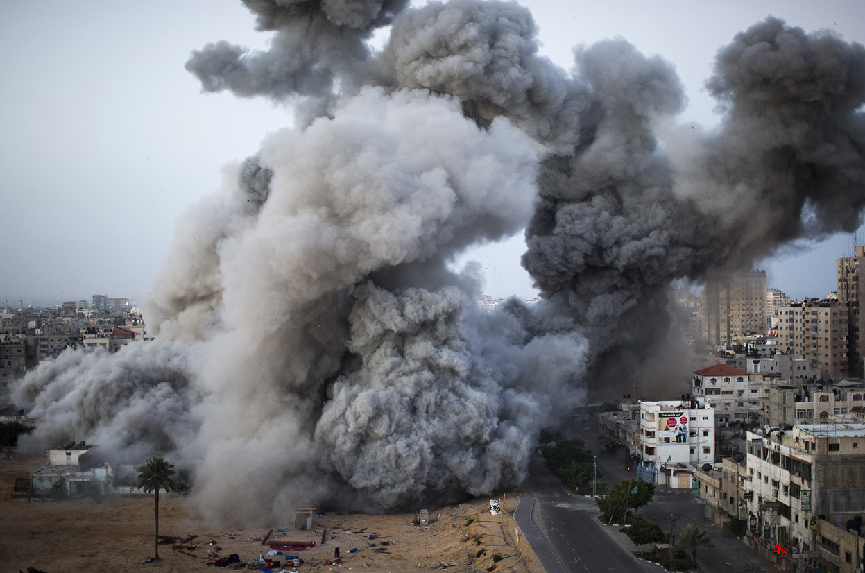 From Israel Steps Up Attacks, Gaza Returns Fire, one of 39 photos. Smoke rises after an Israeli air strike in Gaza City, on November 18, 2012. The Israeli military widened its range of targets in the Gaza Strip on Sunday to include the media operations of the Palestinian territory's Hamas rulers, sending its aircraft to attack two buildings used by both Hamas and foreign media outlets. (AP Photo/Bernat Armangue)