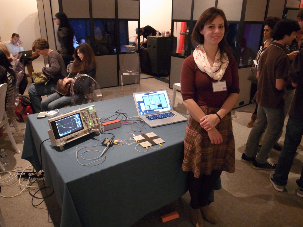 Laura showing off our capacitive musical controller demo at @TEDYouth