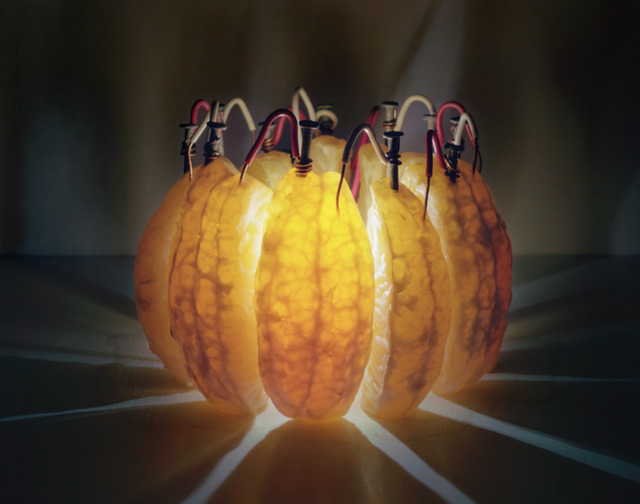 laughingsquid:  A Glowing Battery Made Out of Orange Wedges