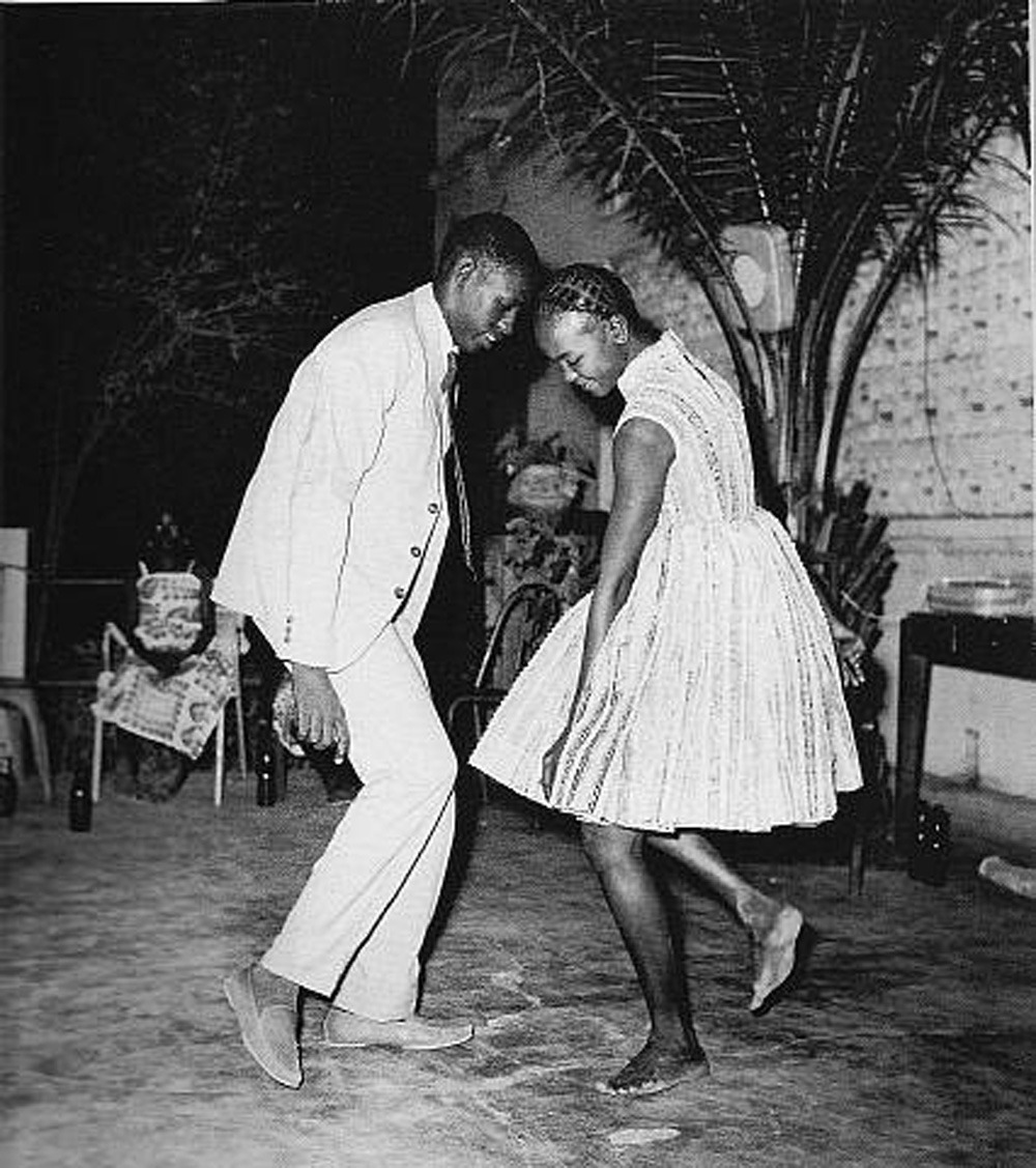 "Christmas Night by Malick Sidibé (1963) Often photographing Malian youth, Malick Sidibé captures the romantic, carefree, ambitious, and overall cool energy that represented the newly independent country. A collection of Sidibé's classic black and white prints, as well as some never-before-seen color prints can be found in the new book ""Malick Sidibé: Portraits of Mali"". Don't miss his exhibition at Galerie du Jour, 44 rue Quicampoix, Paris"