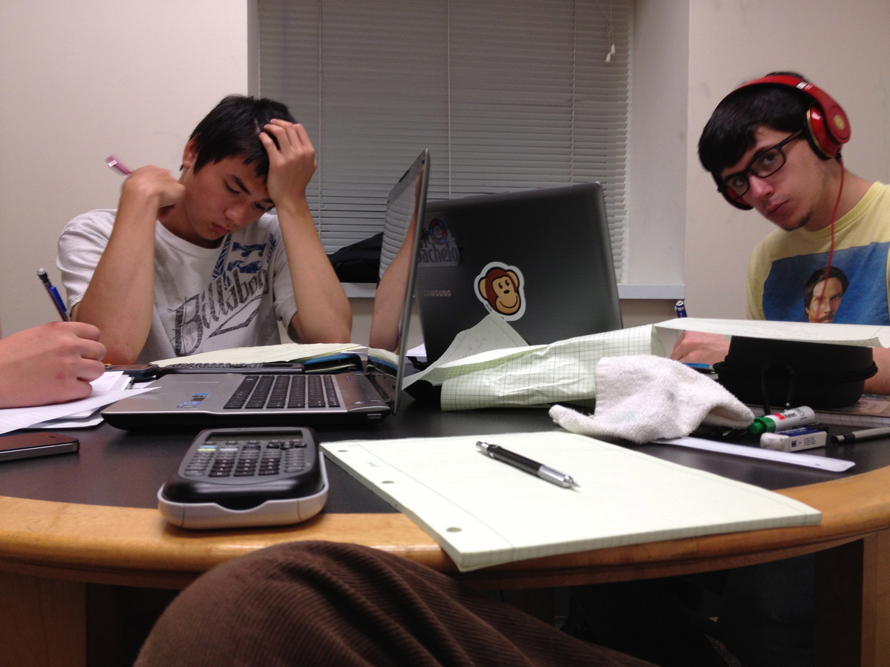 Studying Students.   A biophysicist (left), mechanical engineer (right), and biological engineer (photographer) sit and study for their exam the following day.