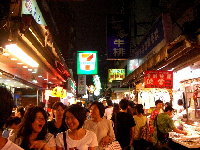 This is a picture of Shida night market in Taipei, Taiwan. Located between two university campuses and two metro stations, Shida night market attracts local students and residence across the city. Stores and vendors sell cheap clothes, accessories, and delicious local and foreign cuisines.One thing interesting in this picture is that one can find both formal (convenient store) and informal (vendors) sitting right next to each other.These streets are normal residential area in the day time with few shops open during the day. At night, it turns into a place of joy. Cheng-Kuan Kan