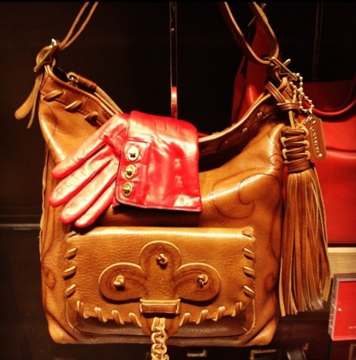 Anna Sui's take on Coach's Legacy duffle, snapped by Nikki Ogunnaike.
