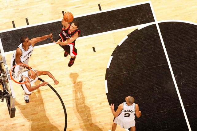 Brandon Roy attempts a layup in traffic during a 2009 Blazers-Spurs playoff game. Roy, now a member of the Timberwolves, will reportedly undergo arthroscopic surgery on his right knee and miss a couple weeks of action. (Greg Nelson/SI) SI NBA BLOG: Brandon Roy in Photos