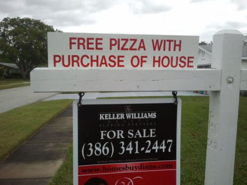 collegehumor:  Free Pizza with Purchase of House  And if you buy in the next ten minutes, you get free plastic utensils too!   pizza and a place to eat it. way to go america.