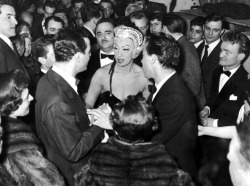 vintageblackglamour:  Josephine Baker surrounded by admirers at the Olympia theater in Paris in the 1940s surrounded by admirers. Her husband, Jo Bouillon and the French singer and actor, Georges Guetary are at her side. Photo: Maurice Zalewski, Gamma-Rapho/Getty.