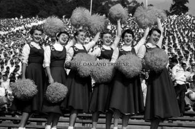 Berkeley, CA November 20, 1954 - California Pom Pom girls help lead the UC rooting section at the Big Game. They are left to right Lynn Pawson, Marlene Anderson, Suzy Palmer, Carol Spicknall, Carol Shultz, and Joyce Johnson. (Oakland Tribune Staff Archives)