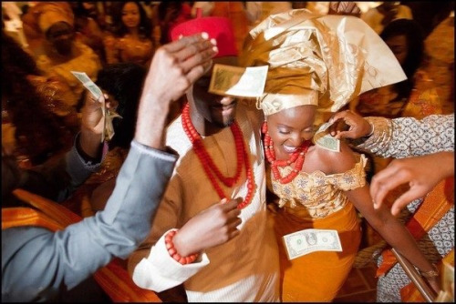 peacegoldlove:  Money dance… It won't be an African celebration without it!
