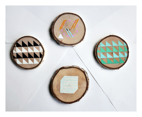 anti-cruise:  mini paintings on birch wood slices im really bad at taking photos even with a super expensive camera with a multitude of functions