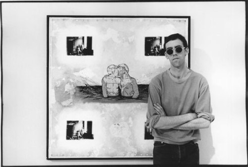artqueer:  David Wojnarowicz in front of his artwork Fuck You Faggot Fucker