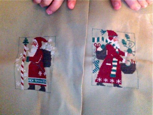 Super crappy webcam photo BUT here are my traditional Santa cross-stitch pieces for the season! I've done at least one every year for the last 4 years and they herald the beginning of the Xmas season for me!