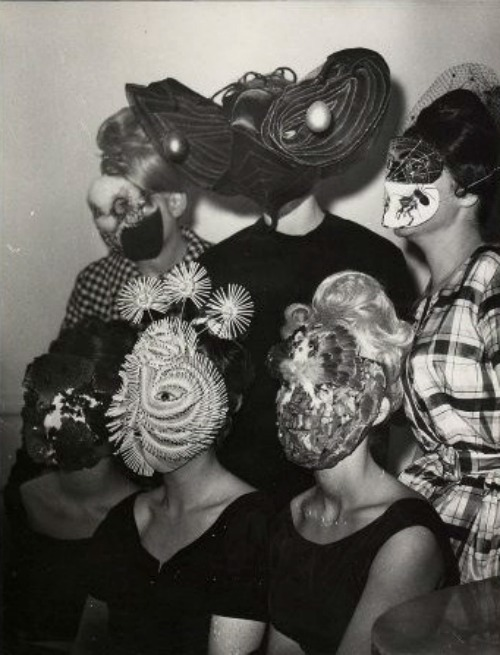 kirgiakos:  Denise Bellon -Gathering of Surrealists group with mask wearing guests  (france | ca.1950s-1960s)