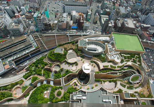 Namba Parks, Osaka, Japan Namba Parks is a public open space in Osaka, Japan located on top of a shopping/office complex. I really thought that this was a novel idea in a very dense setting. In my experience visiting, it is a lively active public space. From wikipedia: Namba Parks was conceived as a large park, a natural intervention in Osaka's dense urban condition. Alongside a 30-story tower, the project features a lifestyle commercial center crowned with a rooftop park that crosses multiple blocks while gradually ascending eight levels. In addition to providing a highly visible green component in a city where nature is sparse, the sloping park connects to the street, making it easy for passers-by to enter its groves of trees, clusters of rocks, cliffs, lawn, streams, waterfalls, ponds and outdoor terraces. Beneath the park, a canyon carves a path through specialty retail, entertainment and dining venues. -Mandy Lee