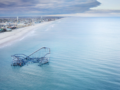 "jenbekmanprojects:  Seaside Heights, Post Sandy by Stephen Wilkes""As I flew over the area, the ocean appeared dead calm; there were no waves, the water looked as if I was in the Caribbean, not the Atlantic,"" says photographer Stephen Wilkes of the November 4 helicopter ride during which he captured this eerie vision of Seaside Heights, NJ. The area was devastated by Superstorm Sandy. The Star Jet roller coaster at Casino Pier—normally a symbol of fun and frivolity—sits in the Atlantic Ocean. This photograph is part of our Art for Sandy Relief project released in collaboration with TIME's photo editors. All net proceeds of these editions support six local charities."